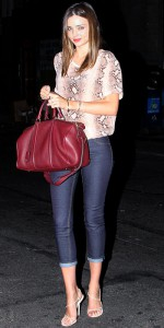 miranda-kerr-in-a-snake-print-blouse-with-cropped-skinny-jeans-a-burgundy-tota-strappy-sandals